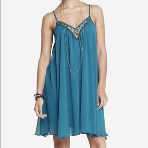 Flowy Dress With Sequin VNeck